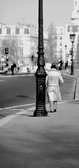Watching The Detectives (Beanotown Photography) Tags: street light blackandwhite paris walking shadows pavement streetphotography lampost spy sheepskin detective elviscostello blackwhitephotos