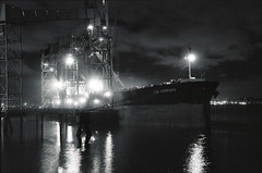 Day 022/365 - Grain Ship at night (Great Beyond) Tags: blackandwhite bw white black slr film water monochrome night analog 35mm project eos boat blackwhite ship image iso400 elevator grain january ishootfilm nighttime 35mmfilm 365 3000v ilford grainelevator afterdark corrado cargoship latent c41 2011 project365 ilfordxp2super400 canoneosrebelk2 filmisnotdead canonrebelk2 latentimage tamronaf28200mm tamron28200mmf3856ldasphericalifsuper january2011 gbcorrado
