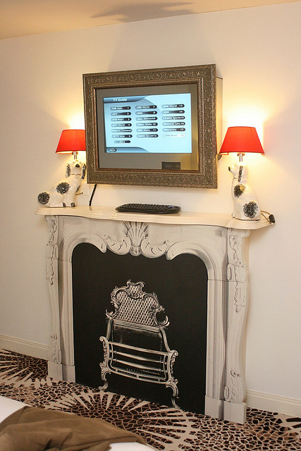 The faux fireplace with TV above it