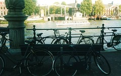 Bikes and Canals (ingroar) Tags: trees netherlands dutch amsterdam vintage buildings bench boats view streetlamp bikes compo canals drawbridge glimpse olanda canalcruise softtones ingroar