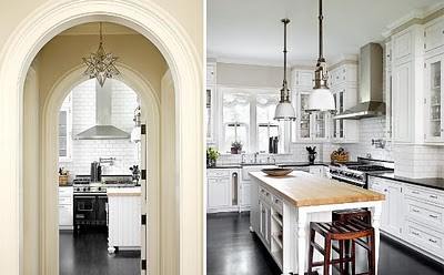 michael_robinson_photography_white_kitchen_subway_tile_backsplash_dark_grey_grout_butcher_block_island_counters_arched_doorway