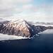Big rock on the coast of the Okhotsk Sea in early winter.