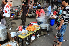 i'm hungry (kolkatamerijaan) Tags: street old morning food woman india breakfast canon eos is market chinese culture streetphotography hungry snacks 1855 potrait streetfood kolkata seller efs bazar southasia 50d poddarcourt territybazar