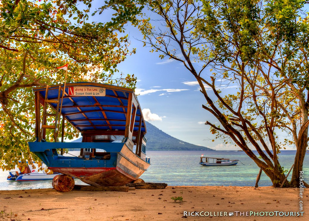 HDR Image - A dive boat pulled up on the beach at Siladen Resort and Spa