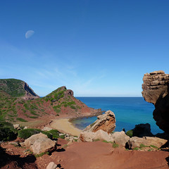 The vivid red coastline of Cala del Pilar (Bn) Tags: blue red sea moon holiday beach water forest swimming swim geotagged island back spain sand woods topf50 mediterranean cove dunes dune rocky peaceful calm unesco formation virgin caves pines limestone vegetation nudist coastline remote calas nudity bays climate isolated menorca laid secluded minorca reddish unspoiled balearic maan hillsides naturists 50faves nuturism caladelpilar geo:lon=3980715 geo:lat=40050388 goemenorca