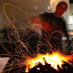 Playing with fire (Gaby.Bernstein) Tags: longexposure male night fire person movement gaby bbq grill barbecue heat glowing ember coal sparks spark bernstein slowshutterspeed colorphotoaward bernsteingaby gabybernstein mygearandme