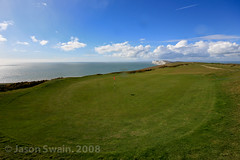 The ninth green at Freshwater Bay Golf Club. (OMG I cant believe its another multiple coastal posting. upload #70) (s0ulsurfing) Tags: blue light shadow cliff sunlight green grass sport club golf downs landscape fun island focus dof play bright pov flag hill perspective sigma wideangle down cliffs course pointofview golfing golfcourse vectis isleofwight fairway 2008 1020 isle wight golfclub westwight tennysondown s0ulsurfing coastuk freshwaterbaygolfclub welcomeuk