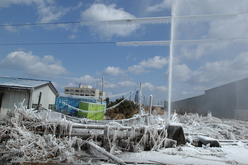 Damaged water pipe shoots water following earthquake off Japan's coast.