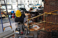 Contractor cuts piping at the Fort Hamilton Co...