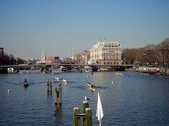 Amstel Hotel en Torontobrug (ednl) Tags: bridge winter holland netherlands amsterdam river march seagull gull nederland sunny bluesky crew rowing regatta brug buoys meeuw roeien amstel earlyspring maart dukdalf rivier headoftheriver amstelhotel eights roeiboot boeien 2011 zonnig nieuweamstelbrug mooringpost blauwelucht 4741 achten rijksmonument rowingshells provincienoordholland vroegelente roeiwedstrijd northhollandprovince ceintuurbaanbrug rm4741