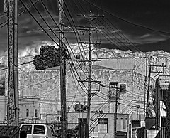 Wires. (Randy Weiner Photography) Tags: street city urban bw detail texture clouds square iso100 blackwhite dc backalley sharp powerlines wires electricity cropped 60mm ac telephonepoles mundane hdr highvoltage blackdiamond topaz urbex photomatix coolshot extremecontrast directcurrent flickrdiamond canoneos5dmarkii photoshopcs4 exoticimage topazdetail2 parisinitafriendsnew