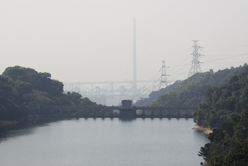 Kowloon Byewash Reservoir, the Stonecutters Bridge is the massive tower in the background, the cranes are at the Kwai Tsing Container Terminals