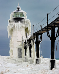 """Frozen Light"" St. Joseph Northpier Lighthouse, St. Joseph, Michigan (Michigan Nut) Tags: winter usa snow cold ice nature geotagged photography frozen frost lakemichigan icicles recent stockimage michiganlighthouses johnmccormick stjosephmichigan stjosephlighthouse michigannut"