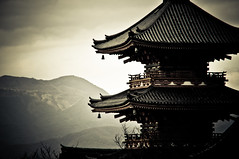 Kiyomizu Dera - Kyoto (mattlindn) Tags: old trees roof sky mountains tower beautiful japan architecture clouds bells buildings landscape temple pagoda scenery kyoto asia pretty cityscape view buddha buddhist traditional religion buddhism unesco   historical restoration kansai region  kiyomizu kiyomizudera atmospheric worldheritage tokugawa rooves evocative iemitsu  japan2010