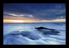 Smooth (Brent McGuirt Photography) Tags: ocean storm clouds sunrise coast rocks long exposure waves fort north fisher carolina wilmington crashing coquina