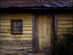The Faded Yellow Door (History Rambler) Tags: door wood old house abandoned home window yellow architecture rural rust south northcarolina historic southern vacant weathered lonely simple antebellum decayed tinroof nashcounty oncewashome