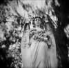 Watching Over (evanleavitt) Tags: camera bw white black film beautiful cemetery statue analog rural ga georgia toy moss holga darkness live south peaceful atmosphere spanish and rest medium format savannah oaks bonaventure 120mm 120n the hcs hauntingly
