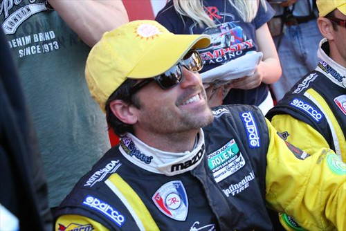 Patrick Dempsey, former INDYCAR team owner, smiles for a fan picture