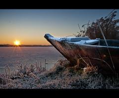 Sunrise (Focusje (tammostrijker.photodeck.com)) Tags: winter sun snow cold holland ice netherlands dutch sunrise boat nederland nieuwkoop nieuwkoopseplassen