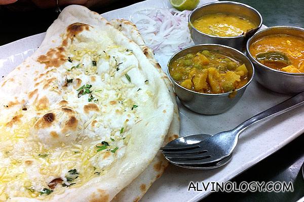 Garlic naan with side veggies