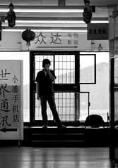 El hombre en la puerta (carlos_ar2000) Tags: street door shadow man argentina silhouette calle puerta buenosaires angle sombra silueta hombre chino belgrano angulo barriochino