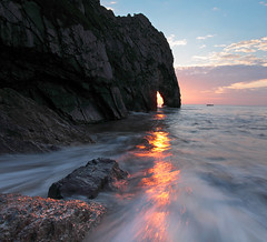 Sliver of Gold (Tony Gill) Tags: sunset waves arch erosion dorset coastline purbeck durdledoor jurassiccoast