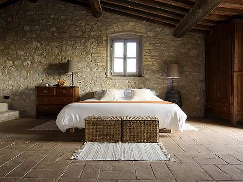 earthy bedroom with stone wall