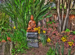 Goddess/God of the Garden at Francis of Assisi Senior Center HDR (Walker Dukes) Tags: sanfrancisco california pink flowers trees red sky black green yellow statue stone canon spring gray lillies pansies adept enlightened dafodils photomatix tonemapping canons95