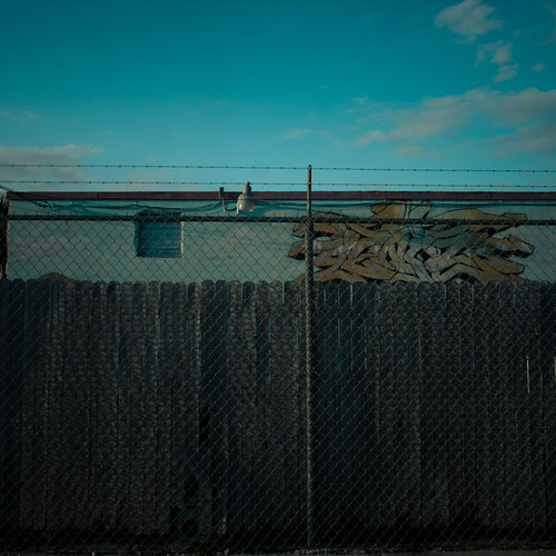 Lawnwower Repair, Chain Link Fence and Graffiti