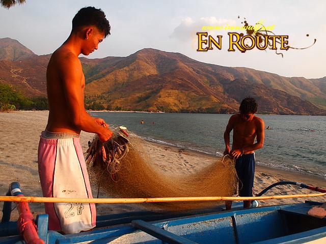 Young fishermen tending their nets
