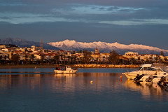 Morning light (Theophilos) Tags: morning light sea sky snow mountains reflection boat greece aurora crete rethymno
