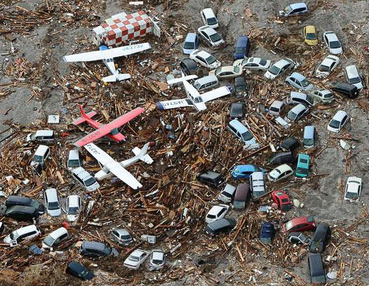 Toy cars and airplanes left on a beach