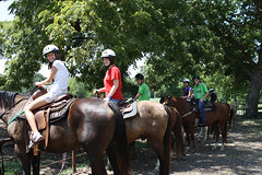 A group of Talent Search students on horses at Sky Ranch.