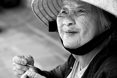 The grand old dame of Hi An (... Arjun) Tags: old light shadow portrait blackandwhite bw woman sun girl monochrome smile festival lady sketch asia afternoon grand monotone unescoworldheritagesite unesco worldheritagesite vietnam hoian f56 dame holi japanesebridge 2010 indochina iso320 ruleofthirds 105mm hian canonef24105mmf4lis bluelist qungnam nnl canoneos5dmarkii canon5dmarkii thubnriver lmpph champacity