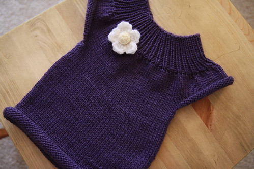 knitted baby top in purple
