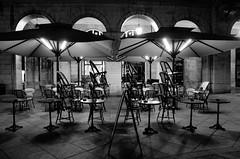 HIRI BARNEA la nuit (Jean-Luc Lopoldi) Tags: bayonne paysbasque bw noiretblanc cafferm terrasse soir nuit night trottoir ville parasols sunshades clairage lighting chaisesempiles chairs tables ombres shadows