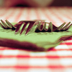 Forks (christian.senger) Tags: red white abstract green texture 6x6 film rollei analog rolleiflex silver mediumformat reflections germany table geotagged europe soft glow dof kodak availablelight napkin fork indoor chrome squareformat sl66 fascination tablecloth minimalism portra ulm lightroom carlzeiss silverfast photostudio13 christiansenger:year=2011