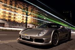 London Never Stops. (Alex Penfold) Tags: park lighting camera light bus london cars alex sports car night canon dark photography photo cool shot nightshot image awesome picture trails fast super exotic photograph lane gto streaks supercar parklane numberplate exotica m12 noble supercars penfold 3r streeks 2011 450d hpyer