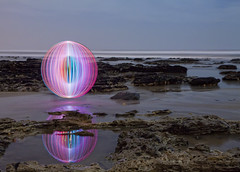 Beach orb (Mike Ridley.) Tags: longexposure pink blue england sky lightpainting colour beach night ball coast crazy spin orb led nighttime coastal northsea coastline nightscene disc orbs pitchblack v24 lenser canon50d lightorb canonefs1755mm28isusm