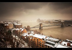 Budapest fentrl (Botond Horvth) Tags: city bridge winter sky house snow color building water architecture clouds river photo nikon hungary cityscape capital budapest parliament chain nikkor duna danube hd magyarorszg cokin 2011 d90 botond horvth foly lnc 1685mm