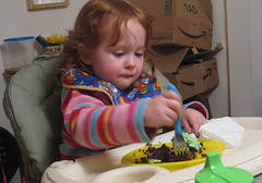 Speck applies fork to cake with great concentration!