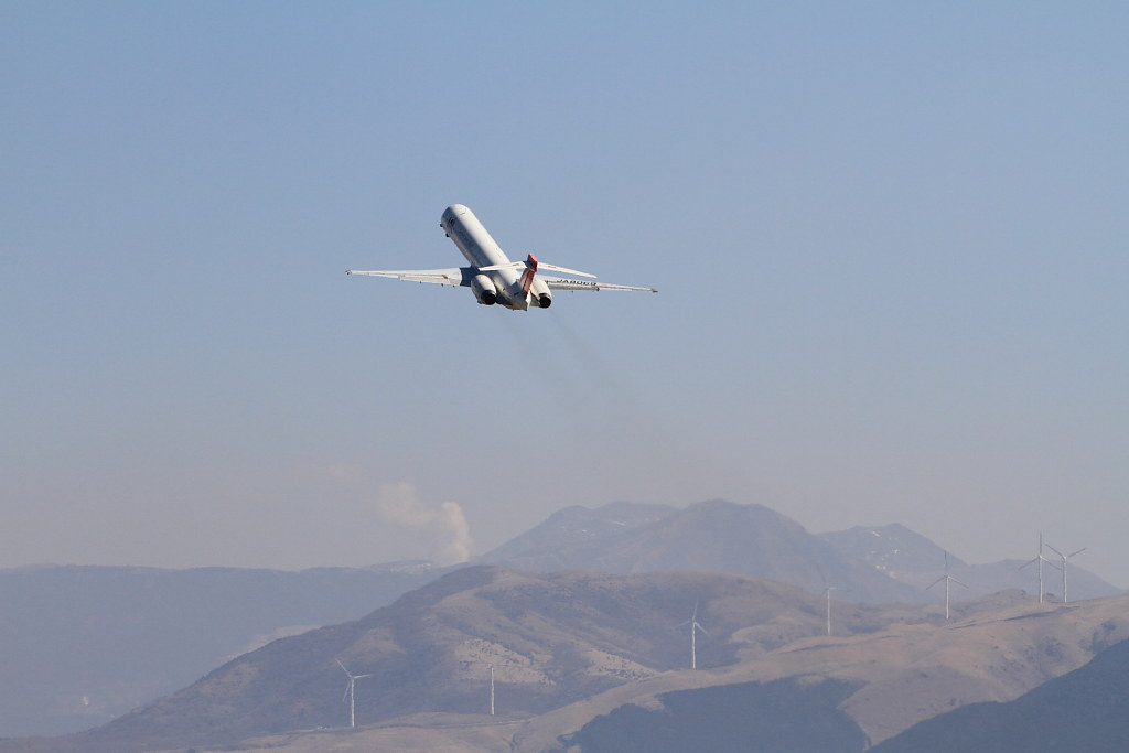 JAL's MD-90 taking off to the sky over Mt. Aso