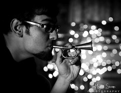 Music and Bokeh : ) [EXPLORE] Feb 26 2011 (Mayank Sharma renewed :D :D) Tags: bw music selfportrait home self canon fun lights hand bokeh trumpet remote tone mayank