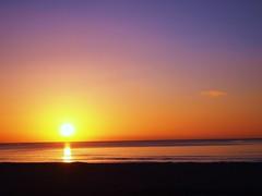 Colors of the Morning (mayauxo) Tags: ocean new morning blue sea sky orange sun color beach nature water colors beautiful yellow sunrise rising day purple violet gradation rise risingsun