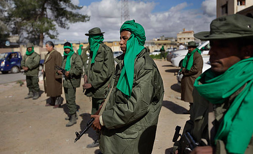 Libyan military forces stand guard at a checkpoint to guard against the counter-revolutionary forces that are backed by U.S. imperialism and its allies. The patriots have made significant headway in defeating the rebels. by Pan-African News Wire File Photos