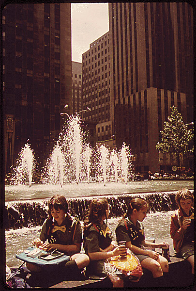Girl Scouts Lunch Alongside Rockefeller Center Fountain 061973 by The US National Archives