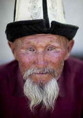 Old Bearded Man With Kalpak Hat, Kochkor, Kyrgyzstan (Eric Lafforgue) Tags: old portrait people man male face hat vertical beard person one asia exterior head oldman headshot moustache elder wisdom mustache centralasia kyrgyzstan wrinkles bearded humanbeing nomads oneperson colorphoto headgear 1072 kochkor kyrgyzrepublic kirghizistan kirgistan kalpak lookingatcamera kirghizstan kirgisistan traditionalhat calpack  calpac nomadiclifestyle   traditionalheadgear quirguizisto kalpakhat kalpac qalpaq
