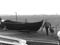 fisher and his boat (MaddiP88) Tags: sea reed boot boat oldman fisher fischer schilf backwater achterwasser