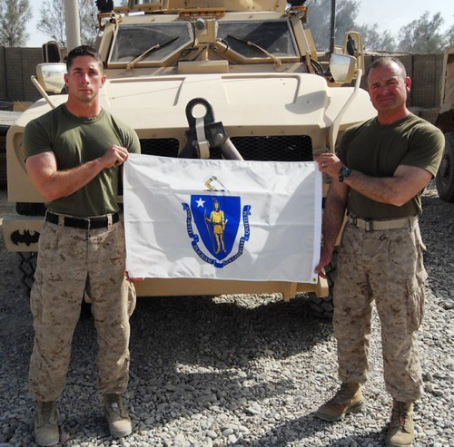 4-4-11 USMC Lt.Gagnon2Oxford Marine proudly displays Massachusetts flag in Afghanistan