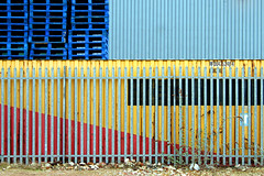 (Delay Tactics) Tags: blue red yellow fence island sheffield diagonal container pallets kelham